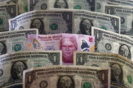 A picture illustration shows Mexican pesos and U.S. dollars banknotes in Mexico City July 6, 2015. Latin American currencies weakened on Monday after Greece overwhelmingly rejected a bailout offer from creditors, though moves were muted as investors bet the fallout would be limited. Nearly every currency dropped against the dollar. Equities markets were broadly lower, with the MSCI Latin American stock index falling for the second straight session. REUTERS/Edgard Garrido