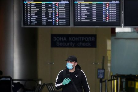 A man passes by at Vnukovo International Airport amid the outbreak of the coronavirus disease (COVID-19) in Moscow, Russia May 22, 2020. REUTERS/Maxim Shemetov