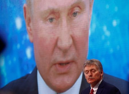 Kremlin spokesman Dmitry Peskov sits in front of an electronic screen during Russian President Vladimir Putin's annual end-of-year news conference, held online in a video conference mode, in Moscow, Russia December 17, 2020. REUTERS/Maxim Shemetov