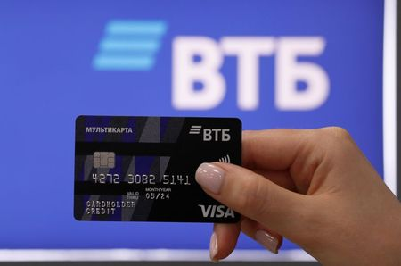 An employee poses for a picture while demonstrating a payment card at a branch of VTB bank in Moscow, Russia May 30, 2019. REUTERS/Evgenia Novozhenina