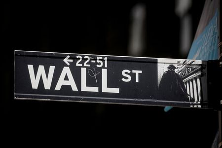 The Wall St. sign is seen near the New York Stock Exchange (NYSE) in New York City, U.S., March 29, 2021. REUTERS/Brendan McDermid