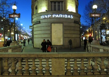 The Paris headquarters of the BNP Paribas bank is seen near the entrance to the Richelieu-Drouot Metro station in Paris, January 28, 2012. A group of BNP Parisbas bondholders has slammed an offer by the French bank to buy back 3 billion euros ($3.95 billion) of hybrid debt, saying the offer was too low and an attempt to bully investors to quickly accept. REUTERS/Mal Langsdon (FRANCE - Tags: BUSINESS CITYSPACE)