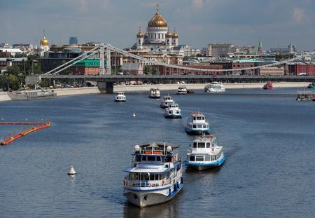 Cruise vessels sail along the Moskva River during an annual parade marking the start of navigation following the easing of lockdown measures, which were imposed to curb the spread of the coronavirus disease (COVID-19), in Moscow, Russia June 23, 2020. REUTERS/Maxim Shemetov