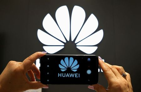 FILE PHOTO: A Huawei logo is seen on a cell phone screen in their store at Vina del Mar, Chile July 18, 2019. REUTERS/Rodrigo Garrido/File Photo