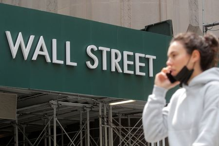 A Wall St. sign is seen near the New York Stock Exchange (NYSE) in New York City, U.S., May 4, 2021. REUTERS/Brendan McDermid