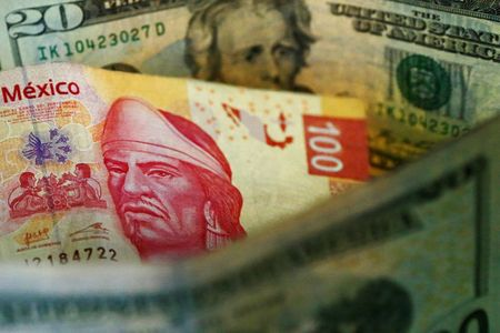 FILE PHOTO: A picture illustration shows Mexican pesos and U.S. dollars in Mexico City March 10, 2015. REUTERS/Edgard Garrido/File Photo