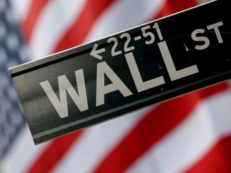FILE PHOTO: A street sign is seen in front of the New York Stock Exchange on Wall Street in New York, February 10, 2009. REUTERS/Eric Thayer/File Photo