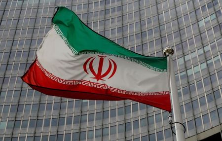 An Iranian flag flutters in front of the International Atomic Energy Agency (IAEA) headquarters in Vienna, Austria, September 9, 2019. REUTERS/Leonhard Foeger