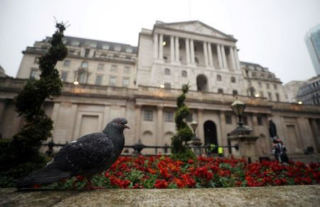 FILE PHOTO: A pigeon stands in front of the Bank of England in London, Britain, April 9, 2018. Picture taken April 9, 2018. REUTERS/Hannah McKay