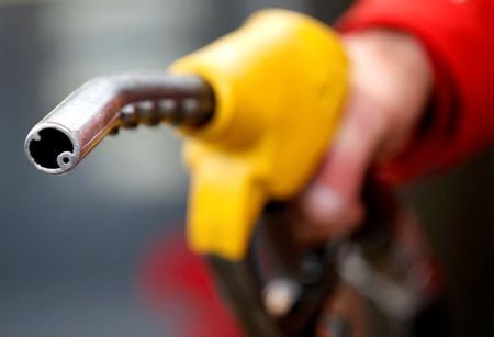 FILE PHOTO: A petrol station attendant prepares to refuel a car in Rome, Italy, January 4, 2012. REUTERS/Max Rossi/File Photo