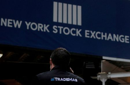 FILE PHOTO: A trader talks on his phone on Wall St. outside the New York Stock Exchange (NYSE) in New York, U.S., January 15, 2021. REUTERS/Brendan McDermid/File Photo