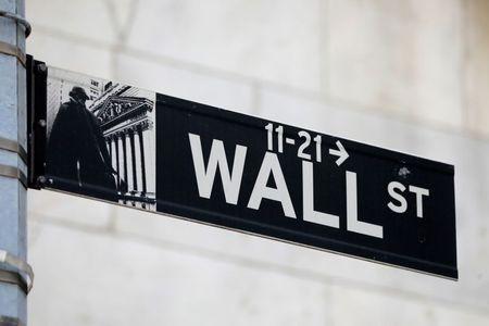 A street sign for Wall Street is seen outside of the New York Stock Exchange (NYSE) in New York City, New York, U.S., June 28, 2021. REUTERS/Andrew Kelly