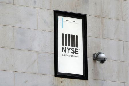 A security camera is seen next to signage outside of the New York Stock Exchange (NYSE) in New York City, New York, U.S., June 28, 2021. REUTERS/Andrew Kelly