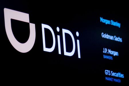 FILE PHOTO: The logo for Chinese ride-hailing company Didi Global Inc is pictured during the IPO on the New York Stock Exchange (NYSE) floor in New York City, U.S., June 30, 2021. REUTERS/Brendan McDermid/File Photo