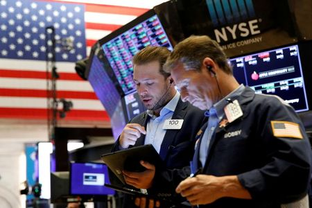 FILE PHOTO: Traders work on the floor of the New York Stock Exchange (NYSE) in New York City, U.S., July 12, 2021. REUTERS/Brendan McDermid/File Photo