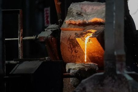 Molten metal is poured into carbon anodes at Century Aluminum Company in Hawesville, Kentucky, U.S. May 14, 2019. Picture taken May 14, 2019. REUTERS/Bryan Woolston