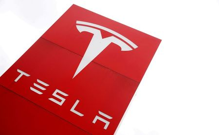 FILE PHOTO: The logo of car manufacturer Tesla is seen at a dealership in London, Britain, May 14, 2021. REUTERS/Matthew Childs/File Photo/File Photo/File Photo