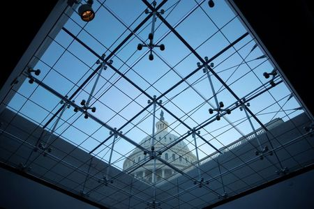 The U.S. Capitol seen through a skylight window at dusk on Capitol Hill in Washington, U.S., September 29, 2021. REUTERS/Tom Brenner